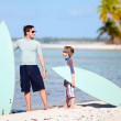 Father and son with surfboards — Stock Photo #13750309