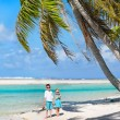 Mother and kids on tropical island — Stock Photo