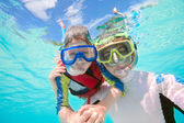 Father and son snorkeling — Stock Photo