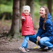 Mother and daughter at autumn park — Stock Photo #13871735