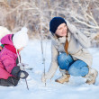 Mother and daughter outdoors at winter — Stock Photo #13871744
