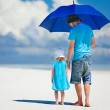 Father and daughter walking at beach — Stock Photo #13871797