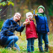 Family at autumn park - Foto Stock