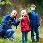 Family at autumn park — Stock Photo #13872369