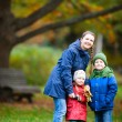 Family at autumn park — Stock Photo #13872416