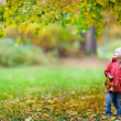 Mother and daughter at autumn park — Stock Photo #13872430