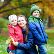 Family at autumn park — Stock Photo #13872522