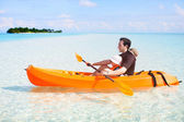 Father and daughter kayaking — Stock Photo