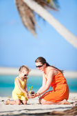 Mother and daughter on a beach — Stock Photo