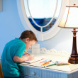 Stock Photo: Little boy drawing or writing