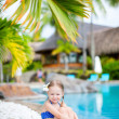 Little girl near swimming pool — 图库照片