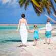 Mother and kids on a tropical island — Stock Photo