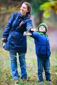 Family at autumn park — Stock Photo