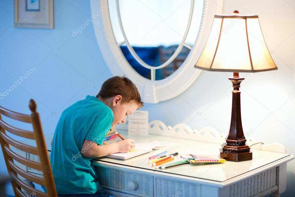 Portrait of cute happy schoolkid at home drawing or writing — Stock Photo #14060536