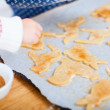 Christmas cookies baking - Stock Photo