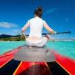 Stock Photo: Womon paddle board