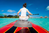Woman on paddle board — Stock Photo