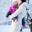Mother and daughter outdoors on winter day - Stock Photo
