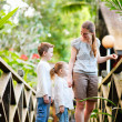 Family at tropical jungle resort — Stock Photo