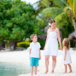 Mother and two kids at beach — Stock Photo