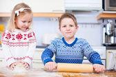 Kids baking cookies or pie — Stock Photo