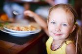 Little girl eating — Stock Photo