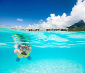 Woman snorkeling in a tropical lagoon — Stock Photo