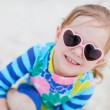 Little girl at beach - Stock Photo