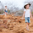 Little girl hiking at scenic terrain - Stock Photo