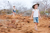 Little girl hiking at scenic terrain — Stock Photo