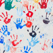 Colorful hand prints - Stock Photo