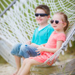 Stock Photo: Kids sitting in hammock