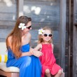 Mother and daughter at outdoor terrace — Stock Photo