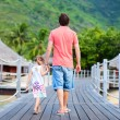 Father and daughter at tropical resort — Stok fotoğraf