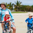 Father and kids riding bikes — Stok fotoğraf