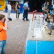 Boy photographing at seafood market - Stock Photo