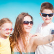 Stock Photo: Family taking self portrait