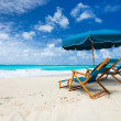 Chairs and umbrella on tropical beach — Стоковая фотография