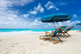 Chairs and umbrella on tropical beach — Stok fotoğraf