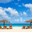 Stock Photo: Chairs and umbrellas on tropical beach