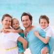 Family on a tropical beach vacation — Stock Photo #22455207