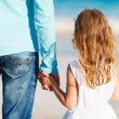 Father and daughter holding hands — Stock Photo #22455677