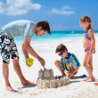 Father and kids playing at beach — Stock Photo