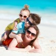 Beautiful family on a beach — Stock Photo