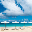 Chairs and umbrellas on tropical beach — Stock Photo #23924849