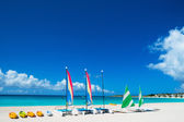 Catamarans on tropical beach — Stock Photo
