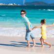 Family at Caribbean beach — Stock Photo #24278813