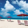 Chairs and umbrellas on tropical beach — Stock Photo #24278967