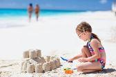 Little girl at tropical beach — Stock Photo
