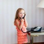 Little girl talking on phone — Stock Photo
